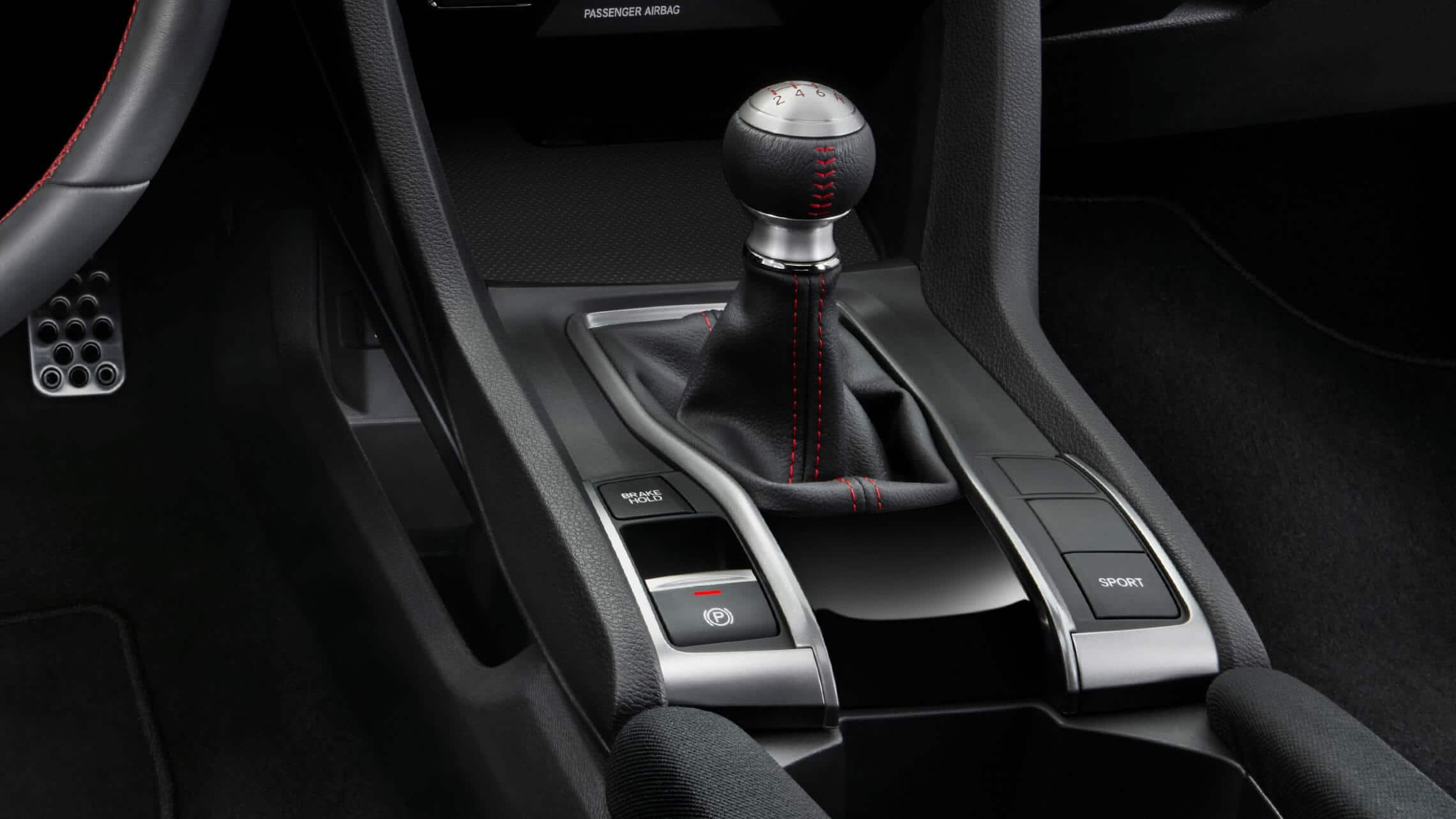 6-speed manual shifter detail with driving-mode controls in 2020 Honda Civic Si Coupe.