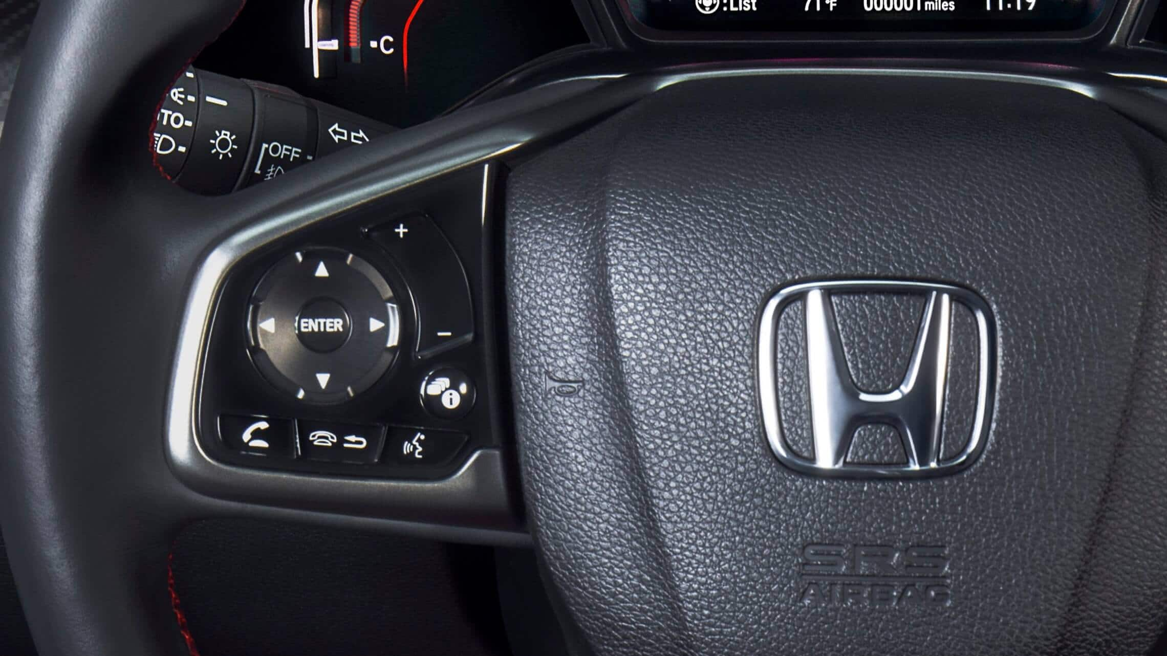 Illuminated steering wheel-mounted controls detail on 2020 Honda Civic Si Coupe.