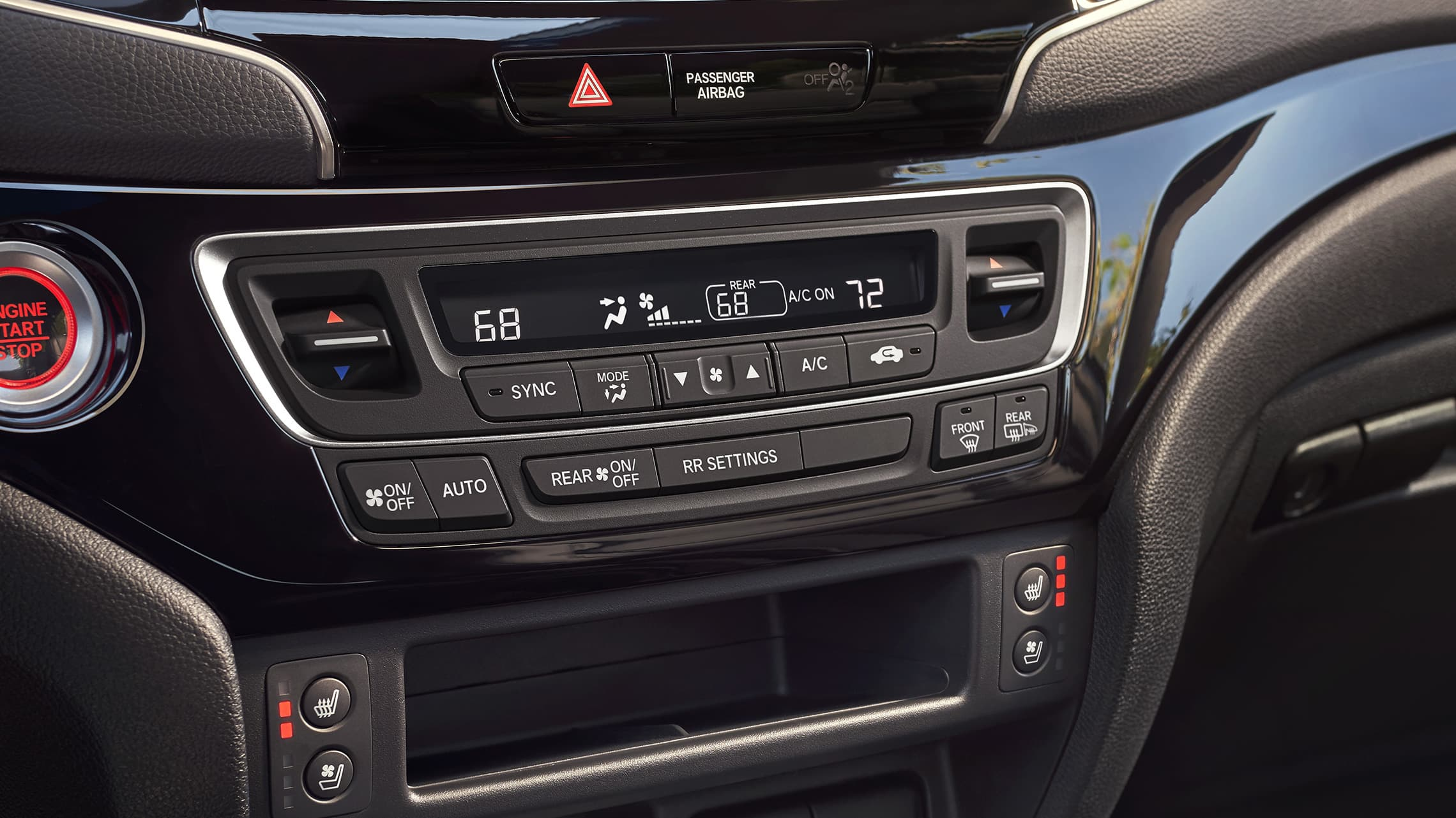Tri-zone automatic climate control detail on the 2020 Honda Passport Elite with Black Leather interior.