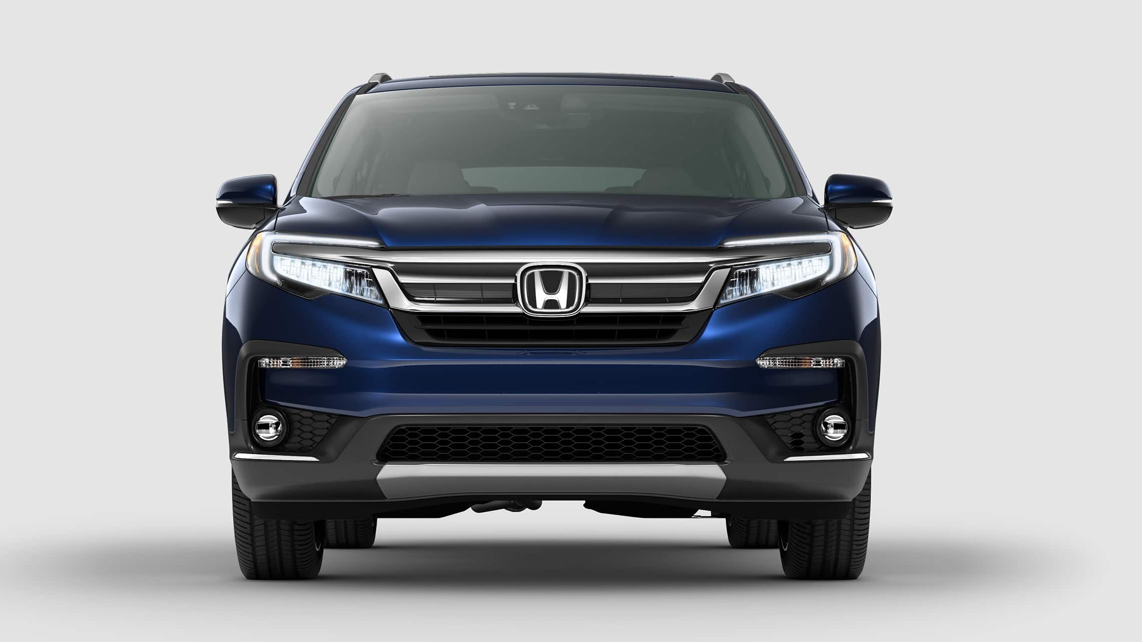 Straight front view of 2020 Honda Pilot Elite in Steel Sapphire Metallic.