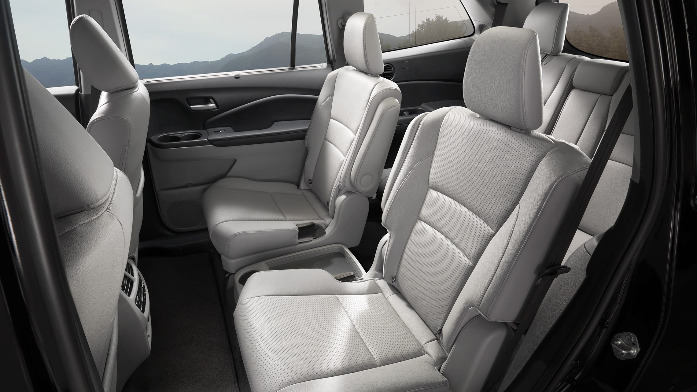 2nd-row captain's chair detail in 2020 Honda Pilot Elite with Gray Leather.